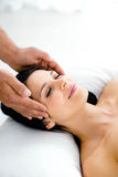 Pregnant woman receiving a head massage from masseur Royalty Free Stock Image
