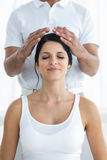 Pregnant woman receiving a head massage from masseur. Pregnant women receiving a head massage from masseur at home Royalty Free Stock Images