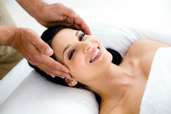 Pregnant woman receiving a head massage from masseur. Pregnant women receiving a head massage from masseur at home Stock Images