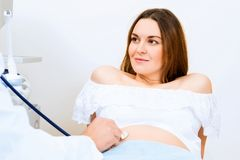 Pregnant woman on reception at the doctor Stock Photography