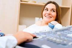 Pregnant woman on reception at the doctor Stock Photos