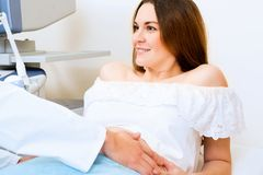 Pregnant woman on reception at the doctor Royalty Free Stock Photography