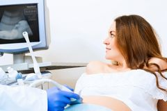 Pregnant woman on reception at the doctor Stock Photo