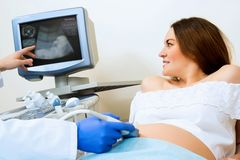 Pregnant woman on reception at the doctor Stock Image