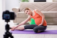 The pregnant woman recording video for blog and vlog. Pregnant woman recording video for blog and vlog Stock Images