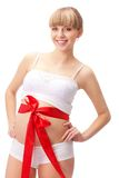 Pregnant woman  with red bow on belly Royalty Free Stock Photography