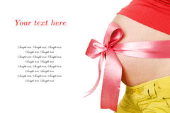 Pregnant Woman with Red Bow and a sample of text Stock Image