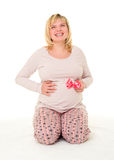 Pregnant woman with red bow. On white royalty free stock photos