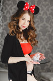 Pregnant woman with red bow. Royalty Free Stock Photos