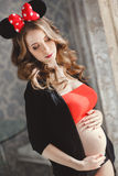 Pregnant woman with red bow. Stock Photos