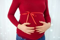 Pregnant woman. In red dress royalty free stock images
