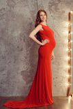 Pregnant woman in red dress Royalty Free Stock Photo