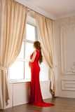 Pregnant woman in red dress Royalty Free Stock Images