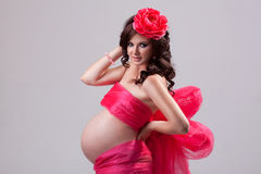 Pregnant woman in red dress. Stock Photos