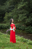 Pregnant woman in red dress Stock Photography
