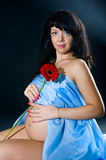 Pregnant woman with red flower Stock Photography