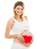Pregnant woman with red heart Royalty Free Stock Photography