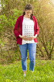 Pregnant woman in red jacket Stock Photos