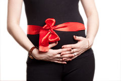 Pregnant woman with red ribbon Stock Photography