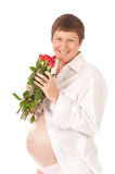 Pregnant woman with red roses Stock Photo
