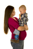 Pregnant woman in red shirt boy sit on belly pouty Royalty Free Stock Images