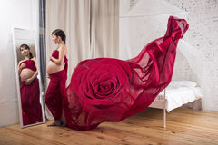 Pregnant woman in red Stock Image