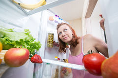 Pregnant woman and refrigerator with health food vegetables Royalty Free Stock Images