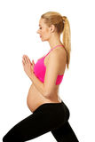 Pregnant woman relax doing yoga Royalty Free Stock Image