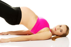 Pregnant woman relax doing yoga Stock Photography