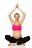 Pregnant woman relax doing yoga Royalty Free Stock Images