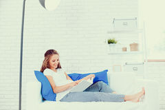 Pregnant woman relaxing on couch. Beautiful healthy pregnant woman relaxing on couch Royalty Free Stock Image