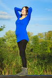 Pregnant woman relaxing and enjoying life in nature Royalty Free Stock Images
