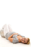 Pregnant woman relaxing on the floor Royalty Free Stock Images