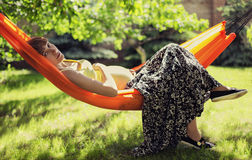 Pregnant woman relaxing in the hammock Royalty Free Stock Image