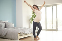Pregnant woman relaxing at home Royalty Free Stock Image