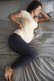 Pregnant woman relaxing at home Stock Photos