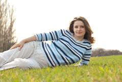 Pregnant woman relaxing on the meadow Royalty Free Stock Photo