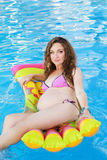 Pregnant woman relaxing near swimming pool Royalty Free Stock Photography