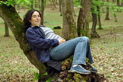 Pregnant woman relaxing on a tree Royalty Free Stock Photo