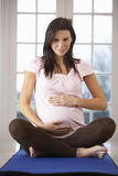 Pregnant Woman Relaxing With Yoga At Home Royalty Free Stock Image