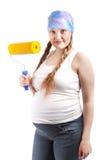 Pregnant woman and repair, studio Stock Photo