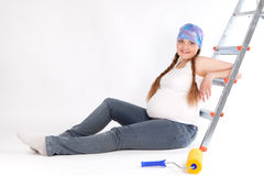 Pregnant woman and repair, studio Royalty Free Stock Images