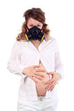 Pregnant woman and respirator holds belly Stock Images