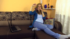 Pregnant woman rest after work at computer, eat fresh grapes stock footage