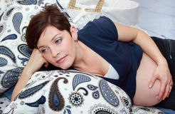Pregnant woman. Resting in bedroom Royalty Free Stock Image