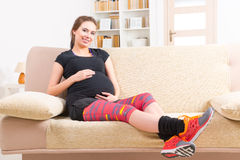 Pregnant woman resting at home Stock Photo