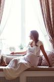 Pregnant Woman Resting on the Sofa Stock Photos