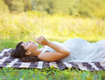 Pregnant woman resting. In summer day royalty free stock image