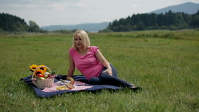 Pregnant woman rests during picnic. Pregnant woman enjoying life stock footage