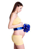 Pregnant woman with ribbon on belly Stock Photography